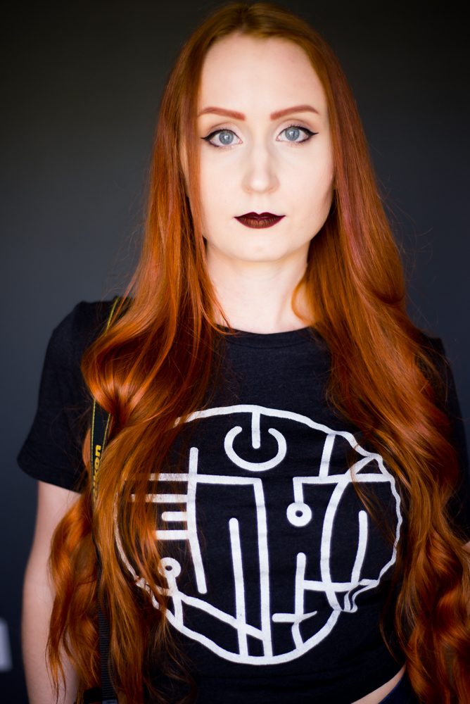 Young woman with bright orange hair