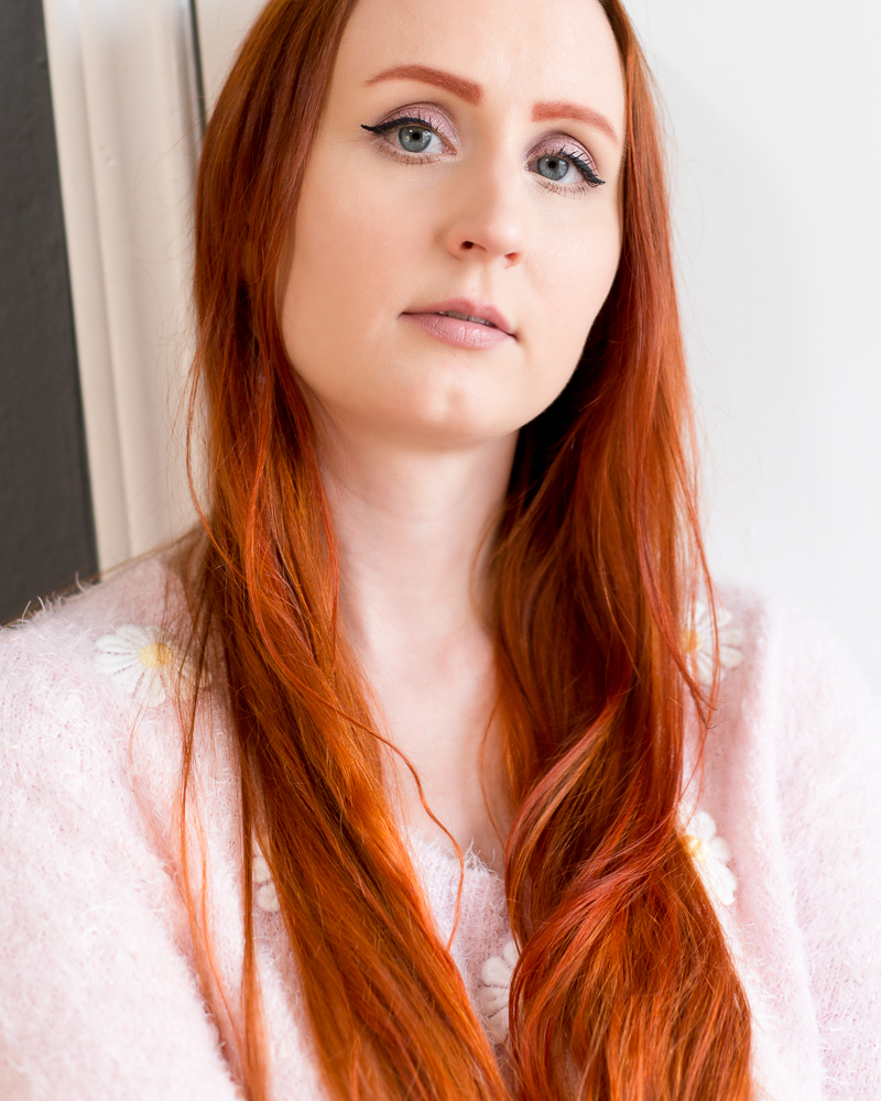 Young woman with long orangey red hair